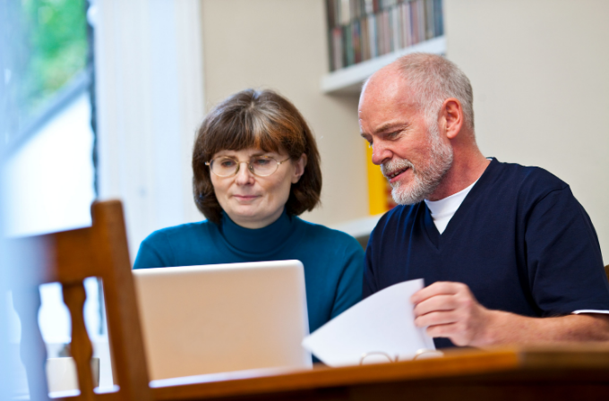 Man and woman on a laptop