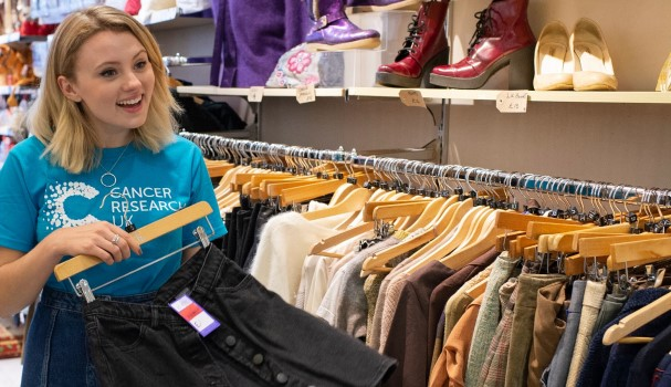 A volunteer by the clothes rail