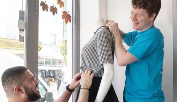 Volunteers making changes to shop window