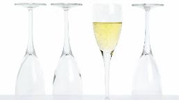 3 empty champagne glasses, 1 full glass